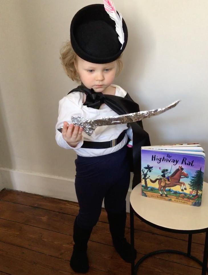 A young child marking World Book Day by dressing as the Highway Rat from the book by Julia Donaldson and Axel Scheffler