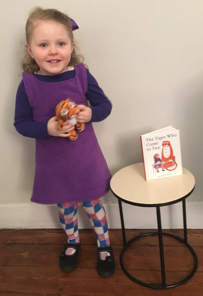 A young girl marking World Book Day dressed as Sophie from the Judith Kerr book The Tiger Who Came to Tea