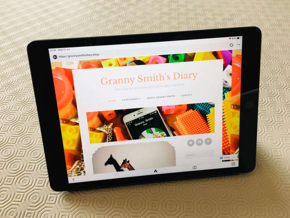An iPad tablet computer, displaying the Granny Smith's Diary homepage on the screen
