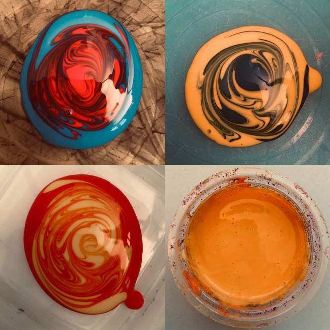 A series of images showing primary colour paints in the process of being mixed, with the final image showing newly created orange paint