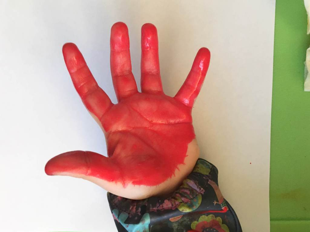 Paint one hand red...