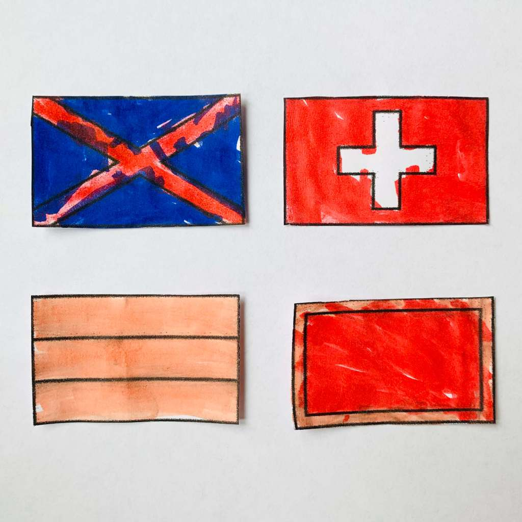 A selection of four flag designs coloured in by a preschool child